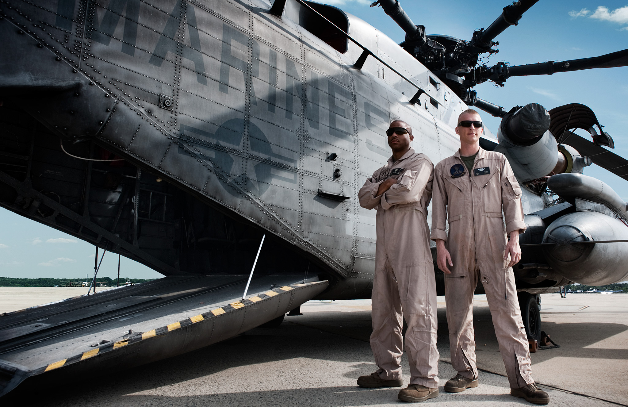 USMC Pilots standing by their CH-53 Helicopter