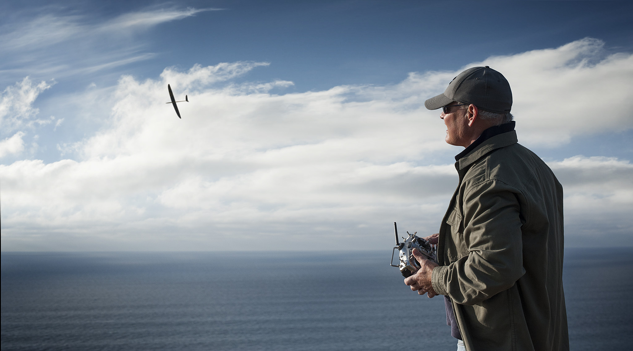 RC Plane flying above the Pacific Ocean