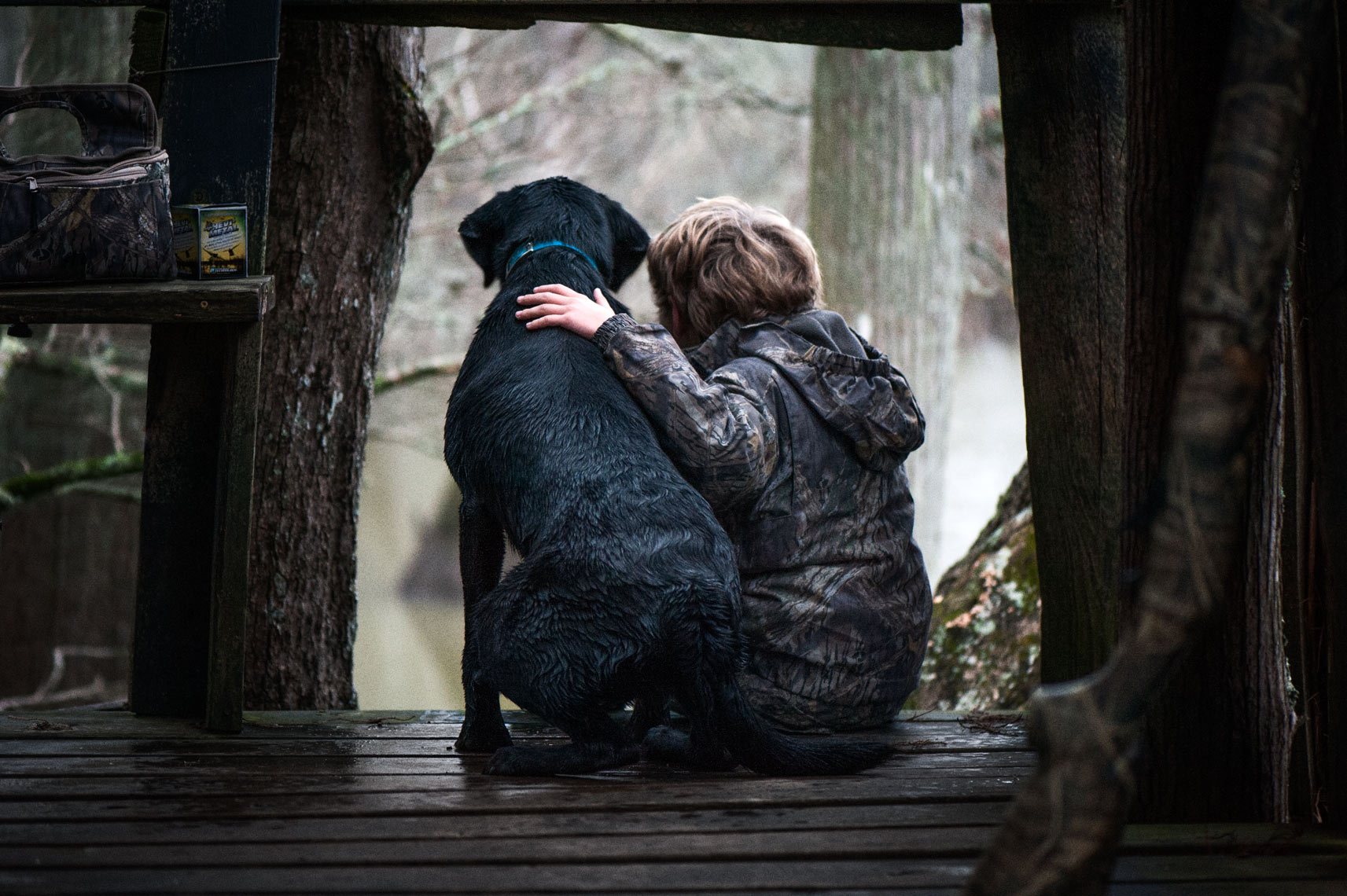 A boy and his hunting dog